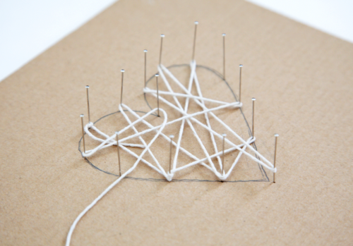 DIY String Art Tutorial on { lilluna.com } So simple and cute! Supplies needed - string, pins, cardboard, a pencil, and a shadow box frame.